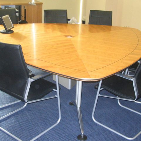 American cherry veneer tri-panel table with black inlay feature, rubber bumper edge & cable management