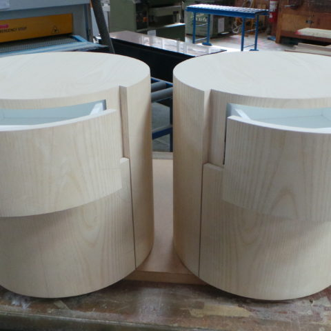 Bespoke moulded side cabinets in timber veneer