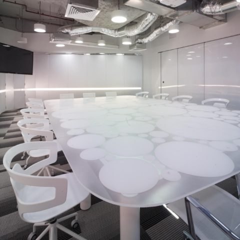 Bespoke underlite perspex boardroom table with custom powdercoated base