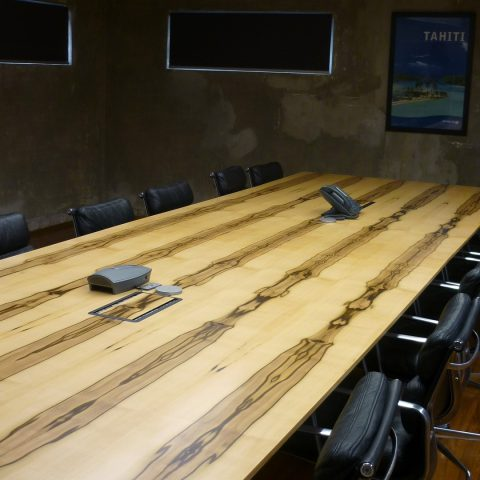 Blackheart Sassafras veneer boardroom table top with integrated cable box