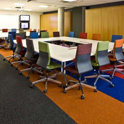 Laminate modular tables with data management and square edge detail