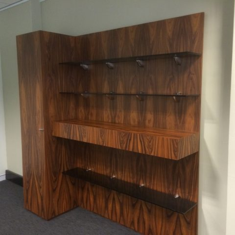 Palisander veneer wall unit & credenzas with smoked toughened glass suspended  shelves