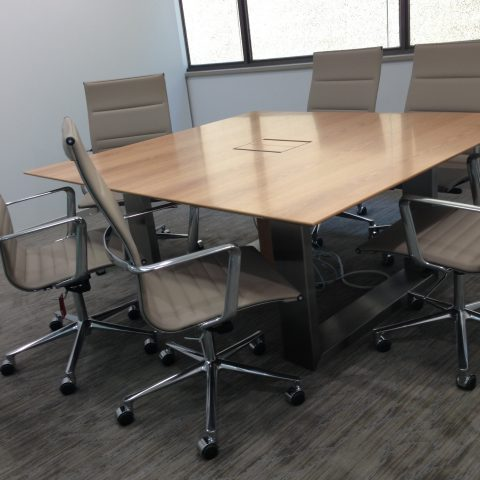 Swiss Pearwood veneer table with cable management, sharknose edge & custom stainless steel sled base