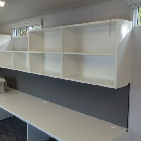Laminate built-in office workstations with matching overhead cabinets & pinboard