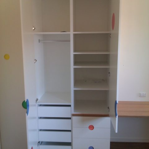 Two pac polyurethane white & multi colour kiddies wardrobe and American Oak desk