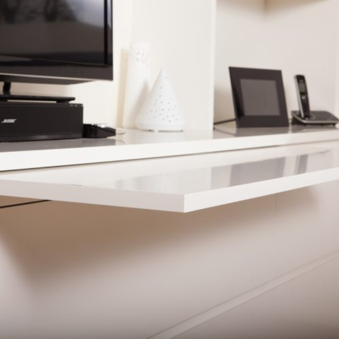 Two pac polyurethane entertainment unit with concealed ledges